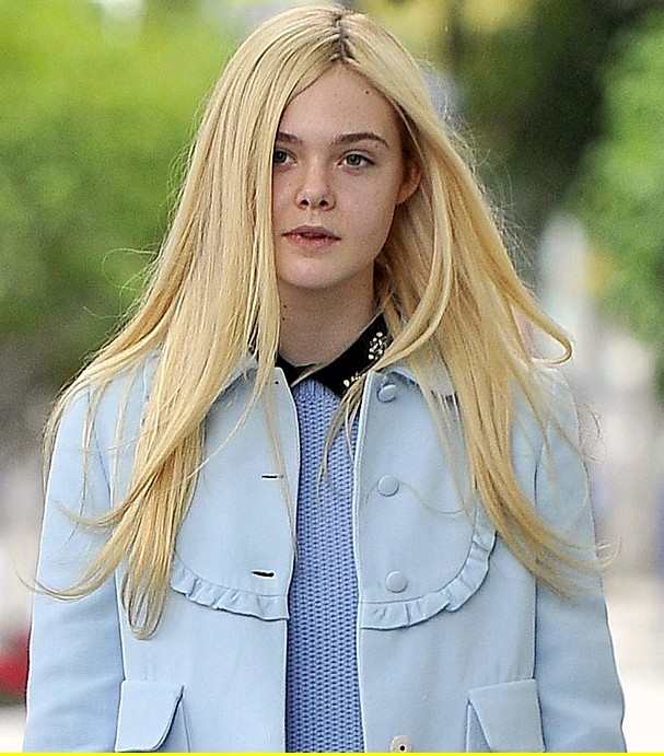 EXCLUSIVE: Elle Fanning wears a blue coat and a black skirt as she heads to lunch at The Milky Way Restaurant in Los Angeles, CA